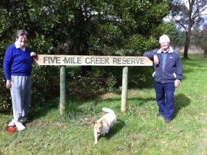 Jo Clancy (Woodend Landcare), Trevor Barker (Upper Campaspe Landcare Network) and Mini the dog at the plant site for Trees for Mum Five Mile Creek Reserve in Woodend.