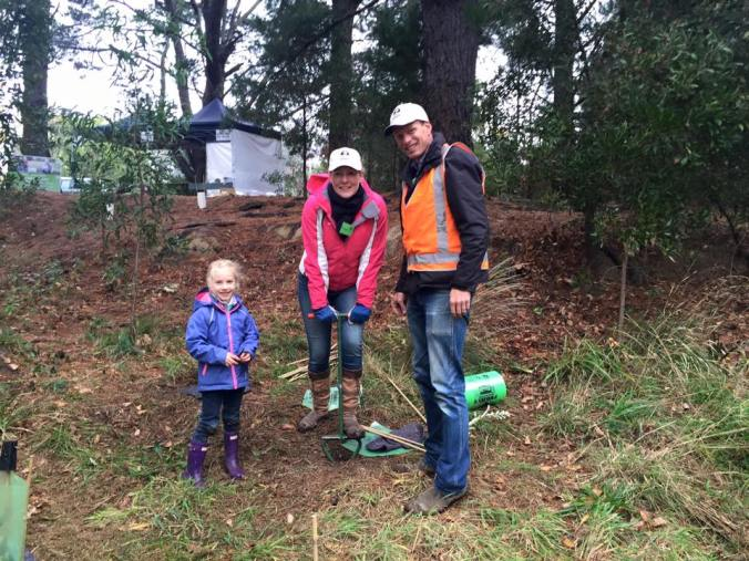 Alice, Angela and Jason planting a tree for granny.